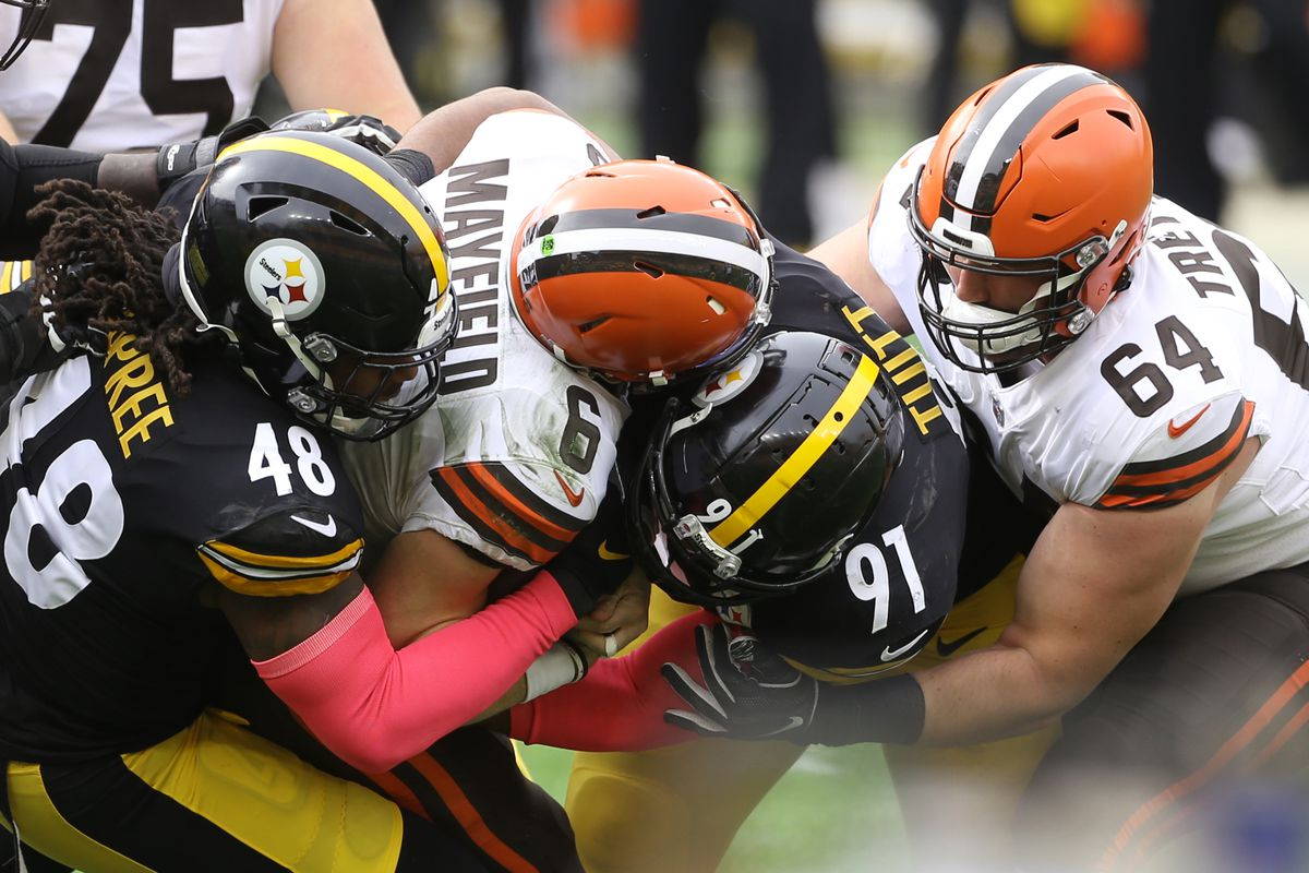 Pittsburgh Steelers outside linebacker Bud Dupree  and defensive end Stephon Tuitt combine to sack Cleveland Browns quarterback Baker Mayfield (6) during the first quarter at Heinz Field.