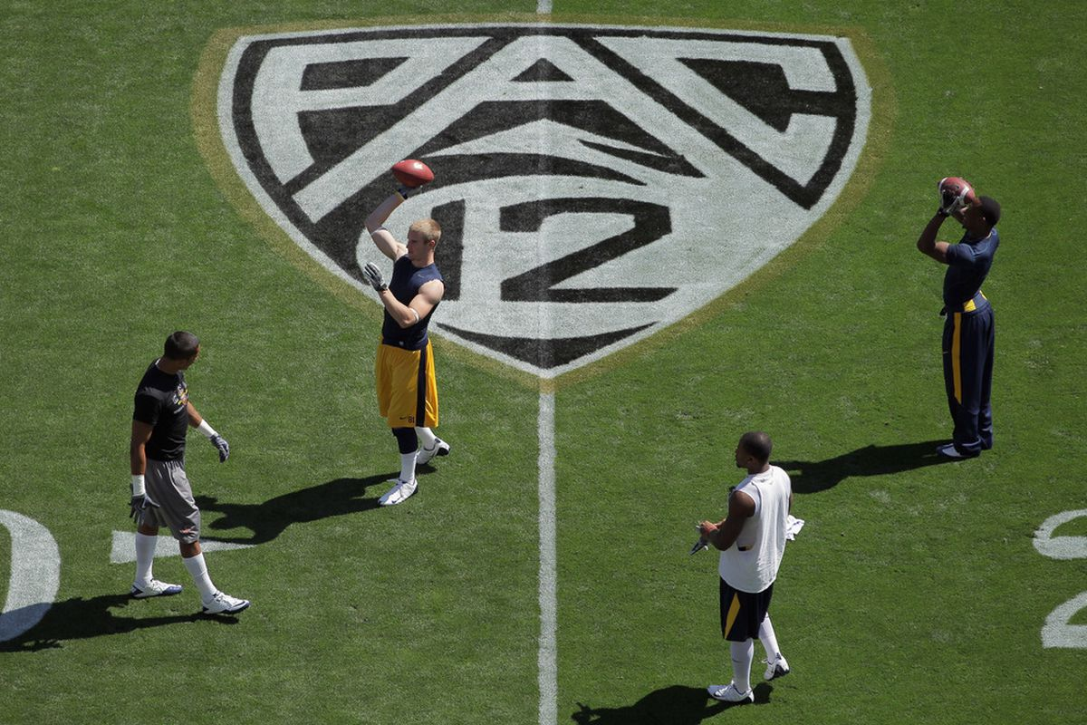 BOULDER, CO - SEPTEMBER 10:  Members of the California Golden Bears warm up prior to facing the Colorado Buffaloes at Folsom Field on September 10, 2011 in Boulder, Colorado.  (Photo by Doug Pensinger/Getty Images)