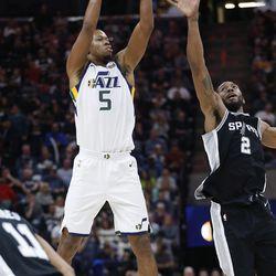 Utah Jazz guard Rodney Hood (5) shoots over San Antonio Spurs forward Kawhi Leonard (2) in Salt Lake City on Thursday, Dec. 21, 2017. Utah won 100-89.