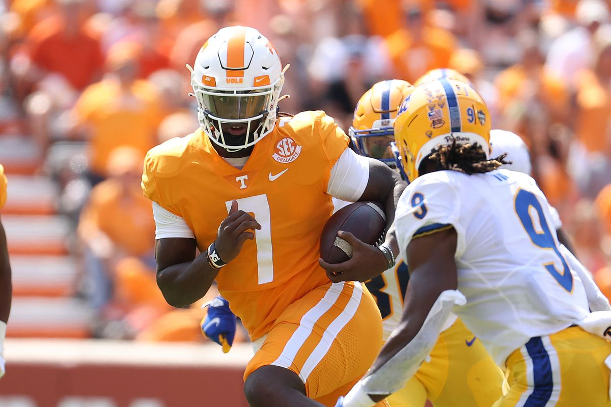 Joe Milton III of the Tennessee Volunteers runs with the ball against the Pittsburg Panthers at Neyland Stadium on September 11, 2021 in Knoxville, Tennessee.