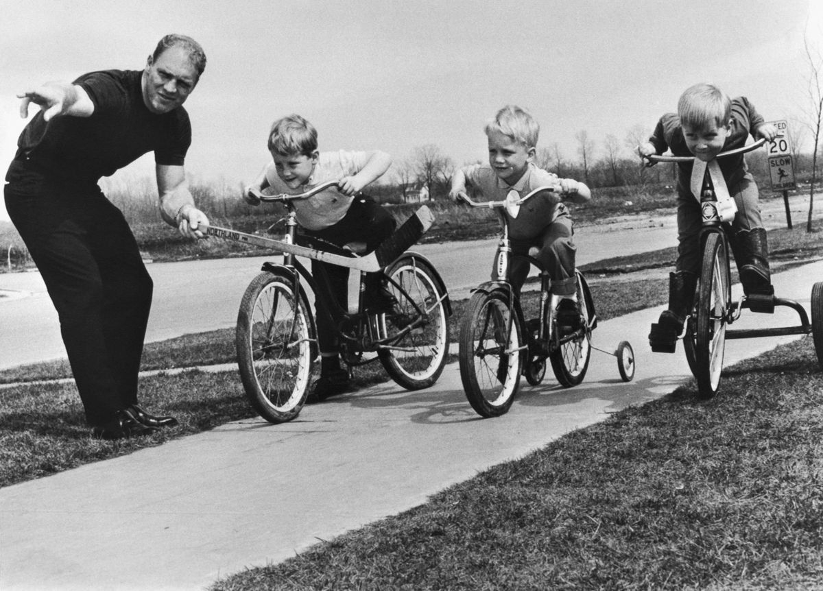 Hockey Player Bobby Hull with His Sons on Bicycles