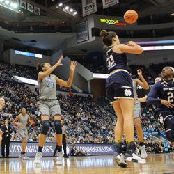 UConn's Crystal Dangerfield (5) throws a pass to Azura Stevens (23) during the Notre Dame Fighting Irish vs UConn Huskies women's college basketball game in the Women's Jimmy V Classic at the XL Center in Hartford, CT on December 3, 2017.