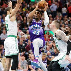 Utah Jazz guard Donovan Mitchell (45) splits Boston Celtics forward Jayson Tatum (0) and Boston Celtics center Daniel Theis (27) as the Utah Jazz and the Boston Celtics play an NBA basketball game at Vivint Smart Home Arena in Salt Lake City on Wednesday, Feb. 26, 2020. Boston won 114-103.