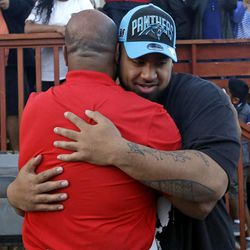 Star Lotulelei, from Utah, receives a hug from his uncle Ti Akau after being selected 14th overall by the Carolina Panthers during an NFL football draft party at their home, Thursday, April 25, 2013, in South Jordan, Utah. For roughly 20 years, Utah has emphasized its ability to recruit polynesian players.