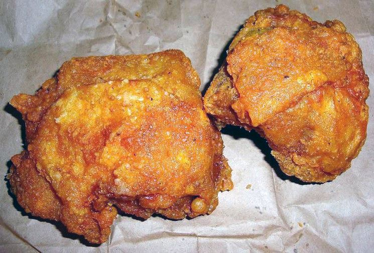 Two pieces of golden brown fried chicken