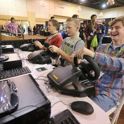 Jake Rowlan, left, Bremmer Bennett and Myles Barney of Morgan High join other students in the Northern Utah STEM Career and College Expo in Layton, Monday, Nov. 9, 2015.