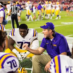 LSU offensive line coach Jeff Grimes instructs his players during a Tigers game. Thursday morning, BYU announced that it has hired Grimes to become the new offensive coordinator at BYU.