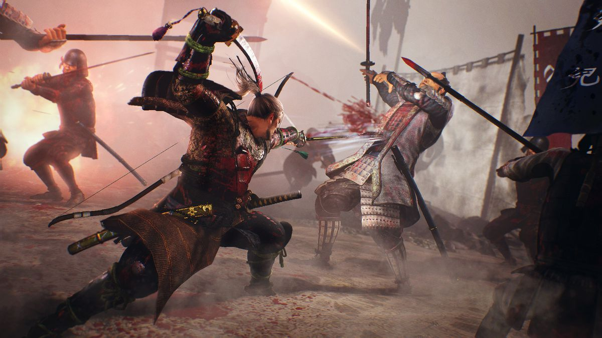 In this Nioh screenshot, protagonist William is seen posing with bloody sword raised over his head. In his other arm, he holds another sword that he has stabbed forward, slicing into an armored opponent. Blood spurts from the opponent's wound as he lurche