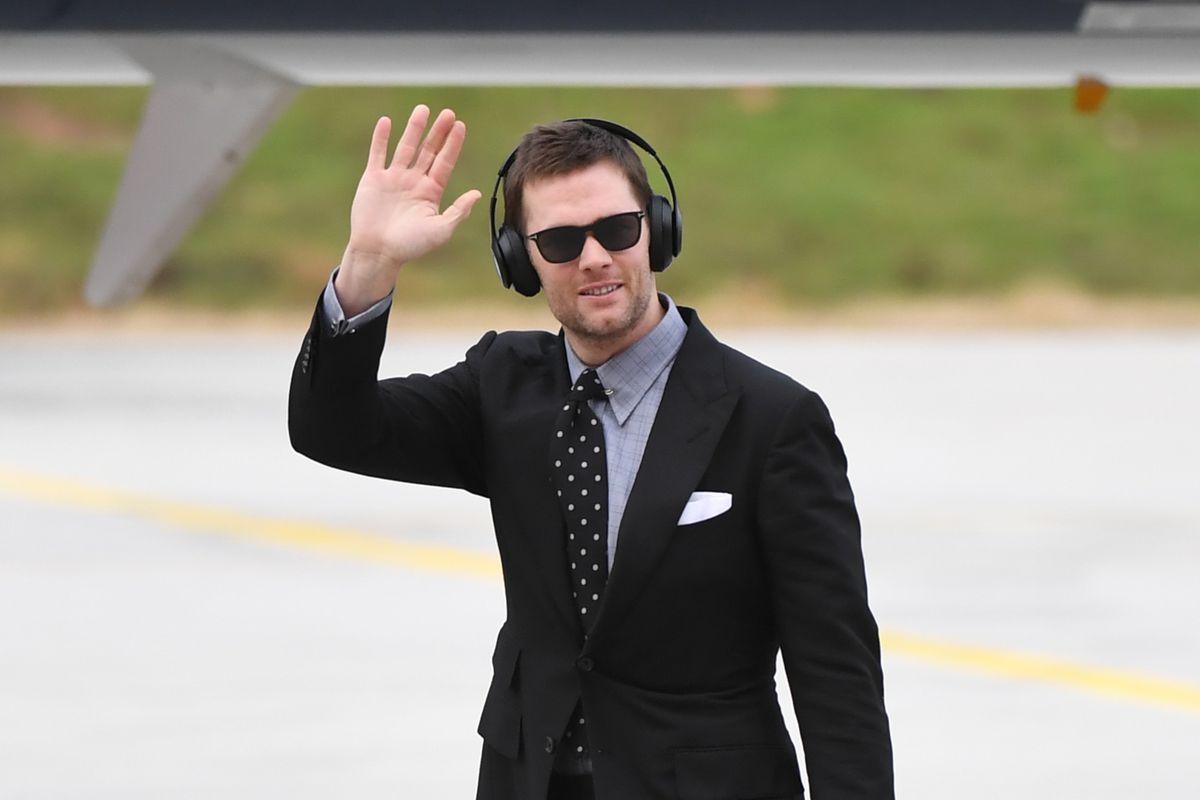New England Patriots quarterback Tom Brady waves at Hartsfield Jackson Atlanta International Airport ahead of Super Bowl LIII.