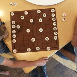 John Hilton, right, plays the Chinese<strong> </strong>board game Xiangqi, which is similar to chess, with son Joseph, 13, in their home in Orem on Thursday, June 25, 2020. Five of Hilton's children attend dual language immersion schools.