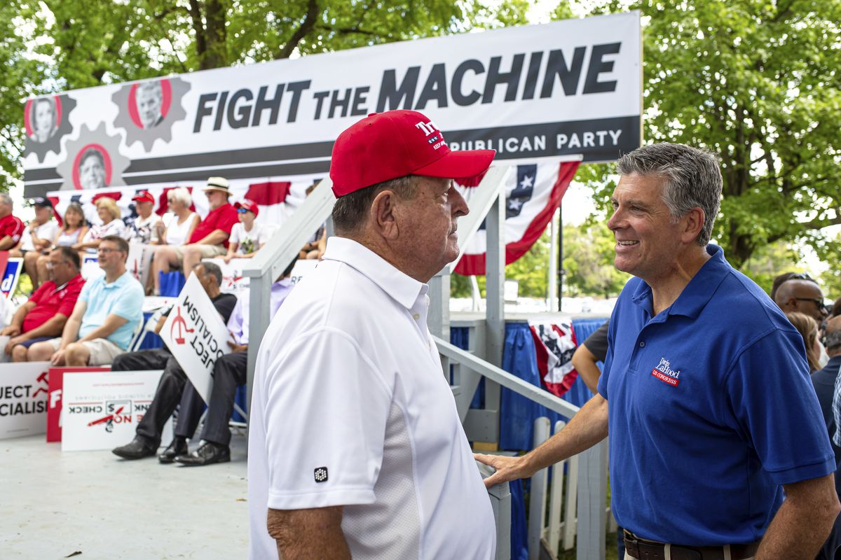 Rep. Darin LaHood, R-Ill., talks with Gary Leming, of Ashland, Ill., during Republican Day at the Illinois State Fair in 2019.