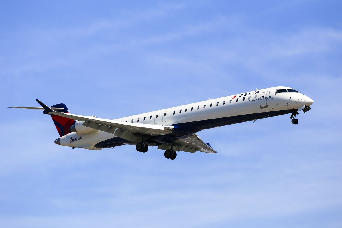 A Delta Airlines airplane landing at Los Angeles International Airport.
