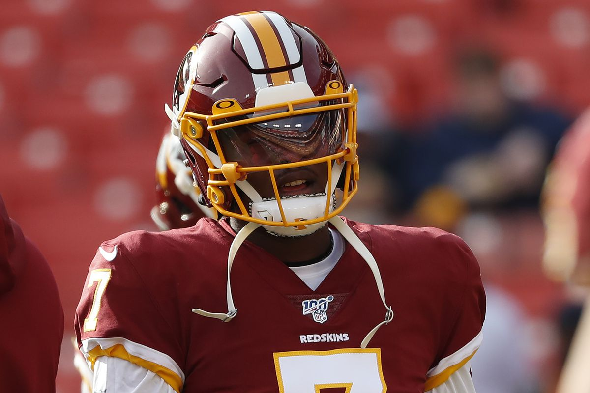 Washington Redskins quarterback Dwayne Haskins stands on the field during warm ups prior to the Redskins game against the New York Giants at FedExField.