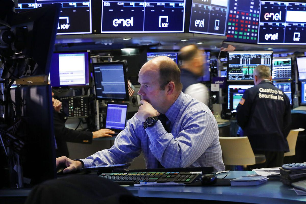 Trader Peter Mancuso prepares for the day's trading, on the floor of the New York Stock Exchange