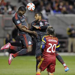 Toronto FC defender Doneil Henry (15) heads the ball in front of teammate Toronto FC defender Jeremy Hall (25) and Real Salt Lake midfielder Ned Grabavoy (20) during a game at Rio Tinto Stadium in Sandy on Saturday, March 29, 2014.