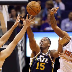 Phoenix Suns' Channing Frye, right, battles Utah Jazz forwards Enes Canter, left, and Derrick Favor (15) for the ball during the first half of an NBA basketball game Friday, Nov. 1, 2013, in Phoenix.