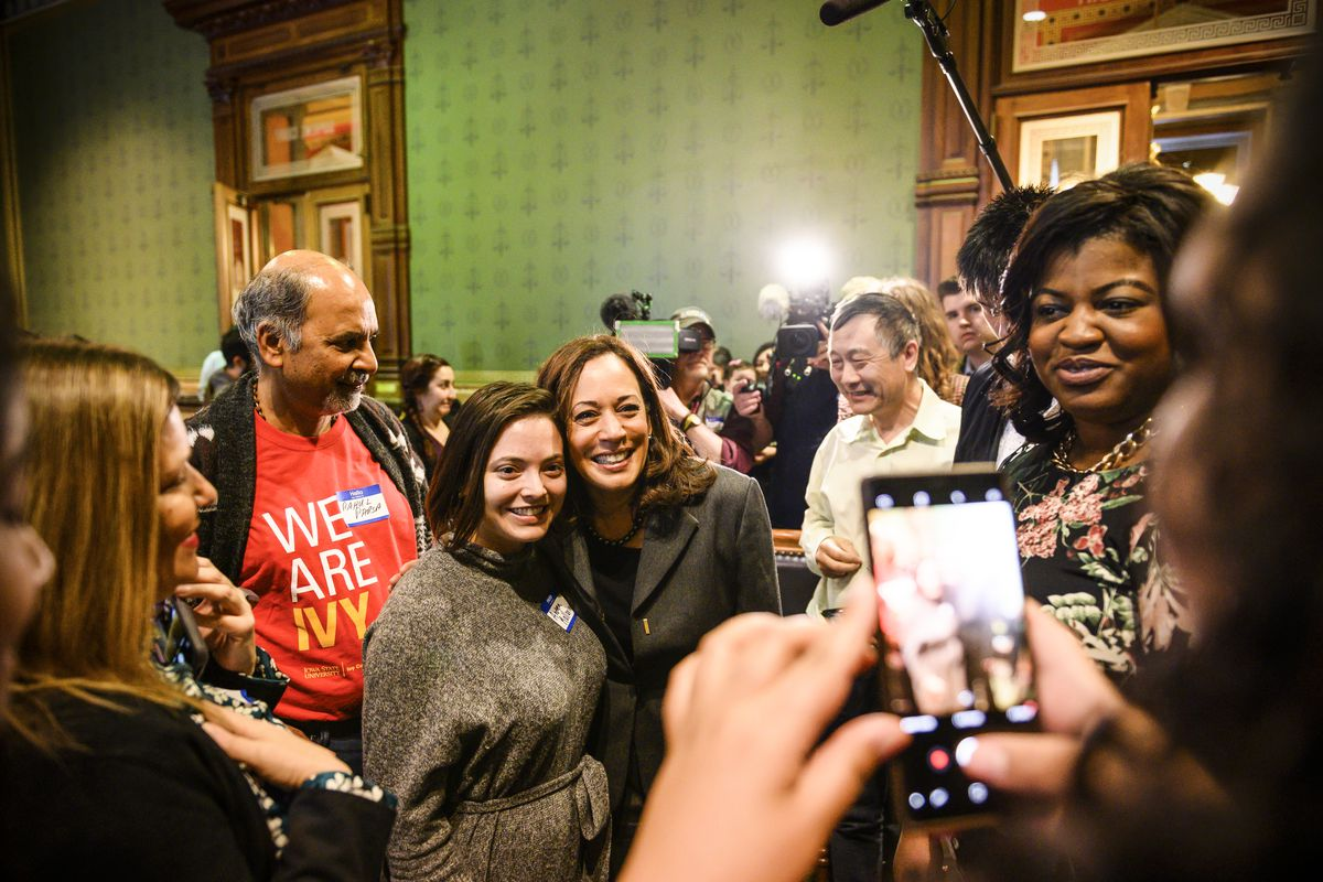 Democratic presidential candidate Sen. Kamala Harris (D-CA) poses for photographs after speaking to the Asian and Latino Coalition at the Iowa Statehouse in Des Moines, Iowa, on February 23, 2019.