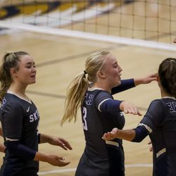 Skyline's Kira Little, center, and teammates celebrate a point over Brighton in Salt Lake City on Tuesday, Sept. 14, 2021.