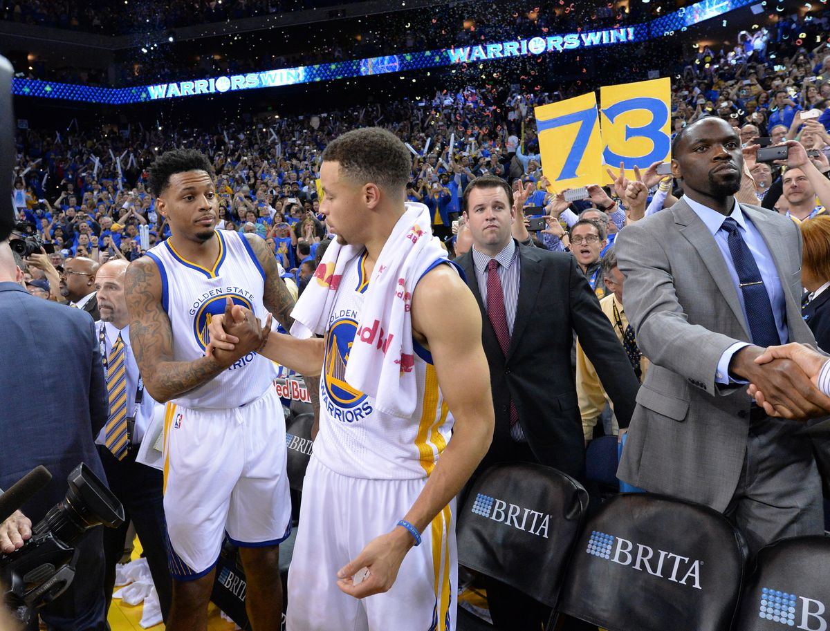 Golden State Warriors' Stephen Curry (30) high-fives Golden State Warriors' Brandon Rush (4), left, following their 125-104 win over the Memphis Grizzlies at Oracle Arena in Oakland, Calif., on Wednesday, April 13, 2016. (Doug Duran/Bay Area News Group)