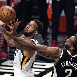 Utah Jazz center Rudy Gobert, left, reaches for a rebound along with Los Angeles Clippers forward Kawhi Leonard during the second half of Game 3 of a second-round NBA basketball playoff series Saturday, June 12, 2021, in Los Angeles.