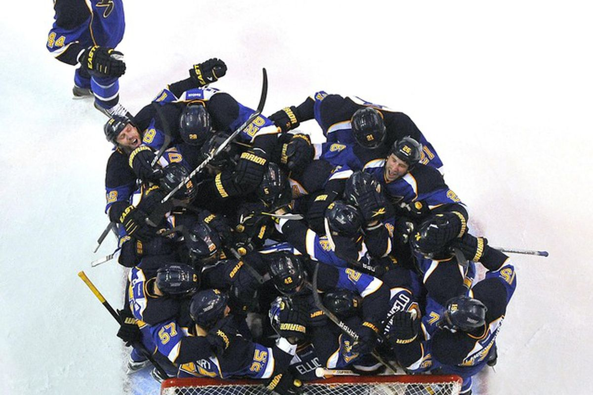 April 21, 2012; St. Louis, MO, USA; St. Louis Blues players celebrate aftergame 5 of the 2012 Western Conference quarterfinals against the San Jose Sharks at Scottrade Center. The Blues won 3-1. Mandatory Credit: Scott Rovak-US PRESSWIRE