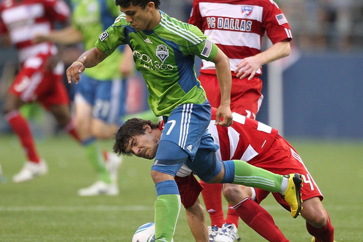 SEATTLE - JULY 11:  Fredy Montero #17 of the Seattle Sounders FC dribbles against Heath Pearce #4 of FC Dallas on July 11 2010 at Qwest Field in Seattle Washington. (Photo by Otto Greule Jr/Getty Images)