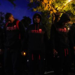 University of Utah football players holding hands pray during a candlelight vigil remembering the life of slain student-athlete Aaron Lowe on Wednesday, Sept. 29, 2021 at University of Utah in Salt Lake City.