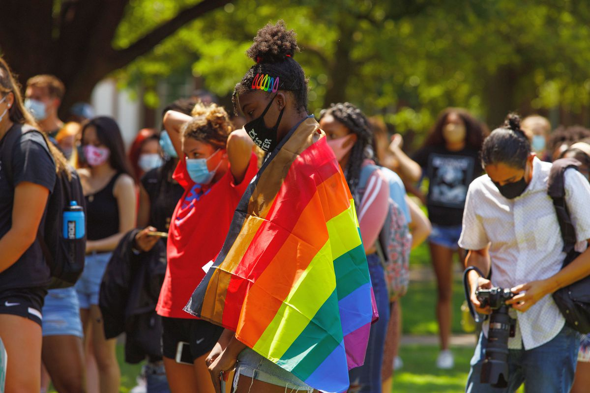 Bri Tollie with Pride flag.