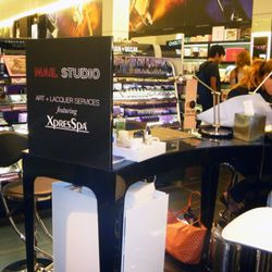The manicure stand is located towards the front of the store,