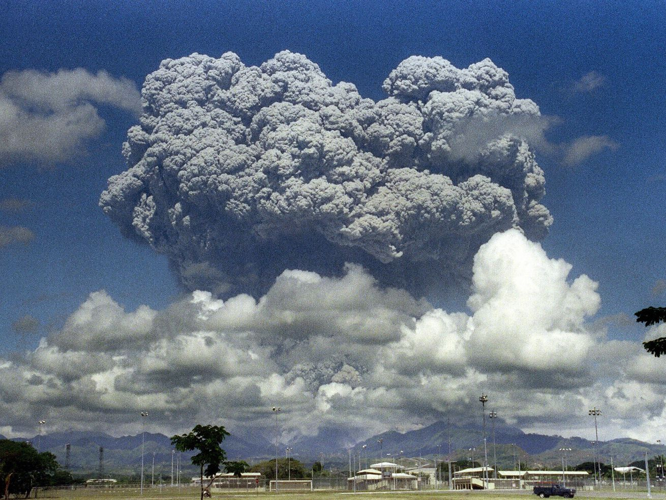 The 1991 eruption of Mount Pinatubo, which substantially reduced global temperatures. Solar geoengineering would aim to lower temperatures by sending similarly-acting particles into the atmosphere.