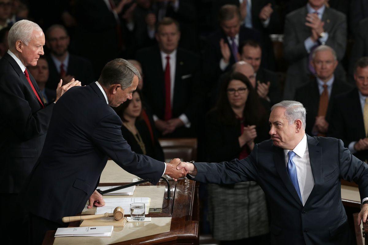 House Speaker John Boehner shakes hands with Israeli Prime Minister Benjamin Netanyahu after his speech to Congress