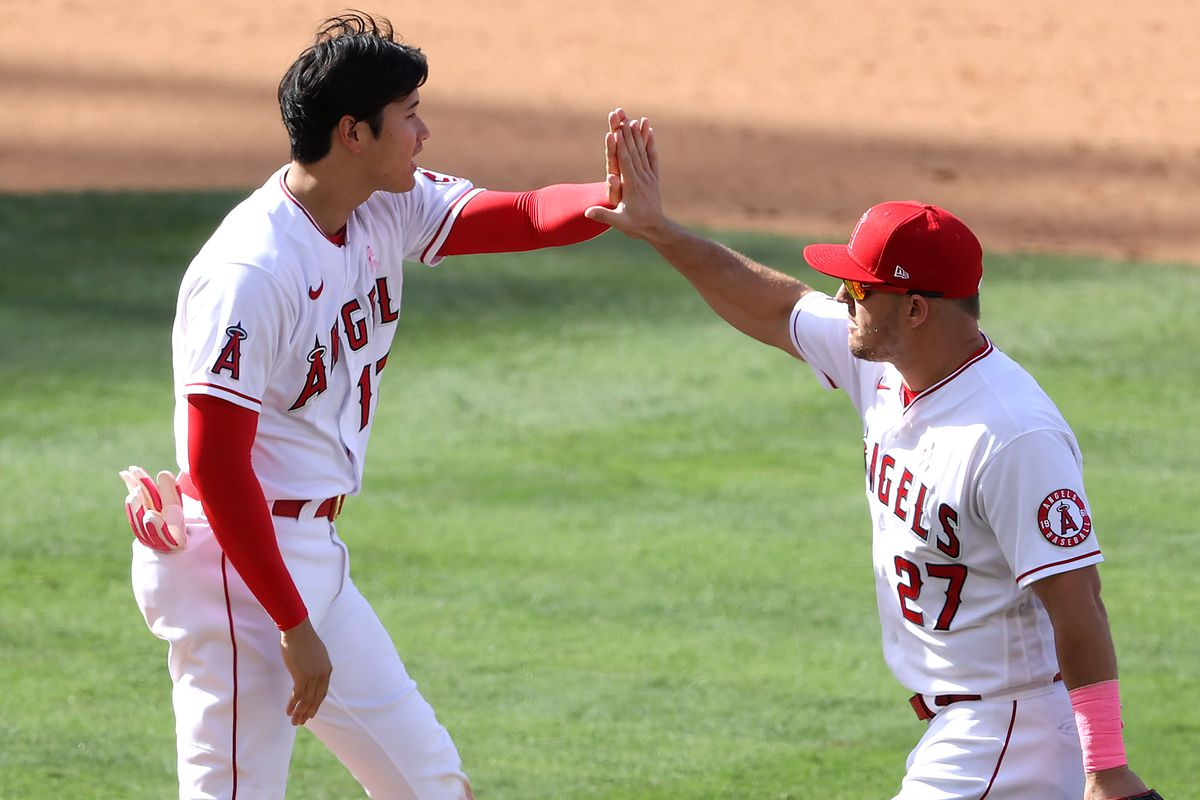 Shohei Ohtani and Mike Trout of the Los Angeles Angels celebrate defeating the Los Angeles Dodgers 2-1 in a game at Angel Stadium of Anaheim on May 09, 2021 in Anaheim, California.