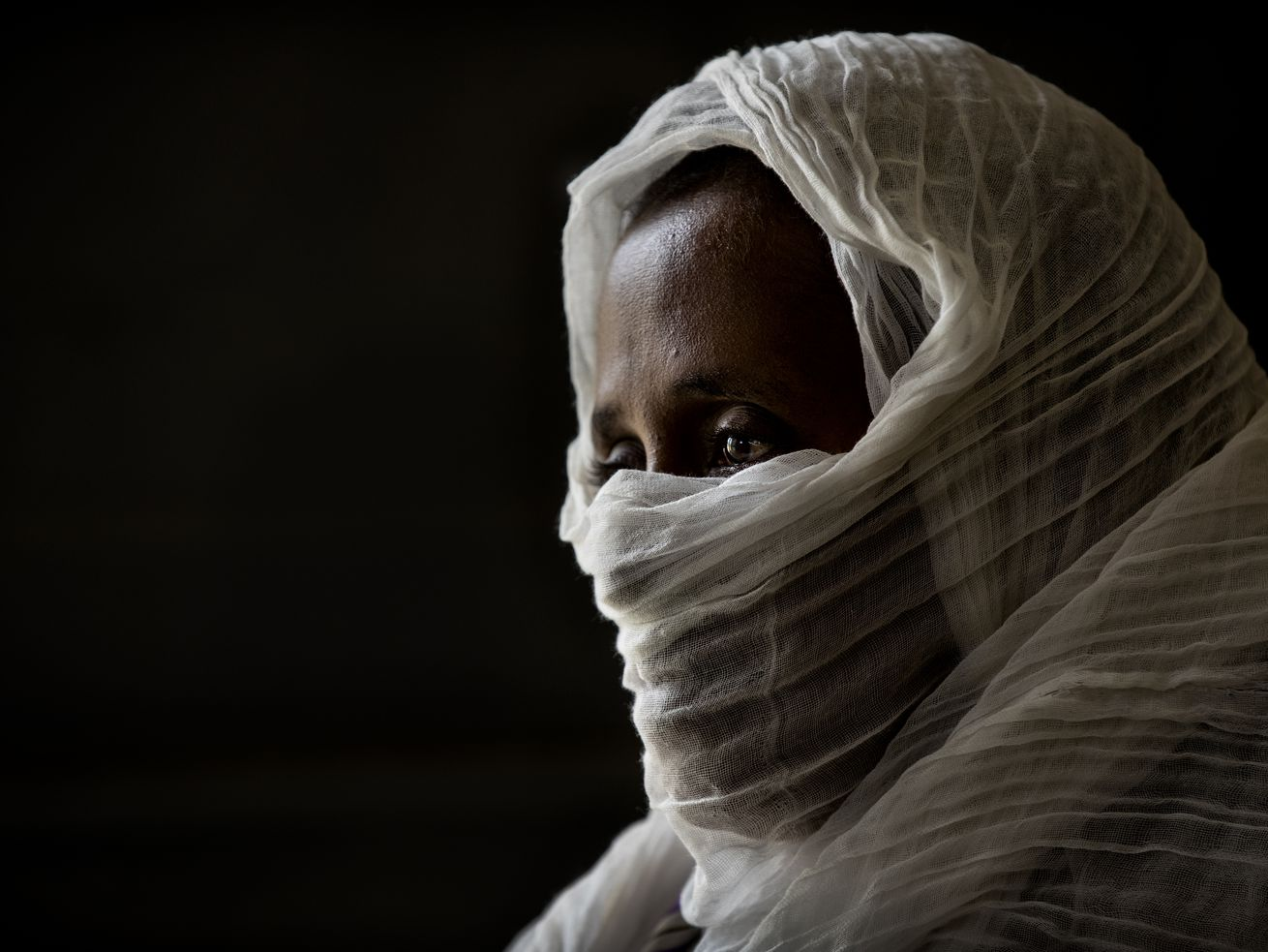 A 40-year-old woman who was says she was held captive and repeatedly raped by 15 Eritrean soldiers over a period of a week in a remote village near the Eritrea border, speaks during an interview at a hospital in Mekele, in the Tigray region of northern Ethiopia, on Friday, May 14, 2021.