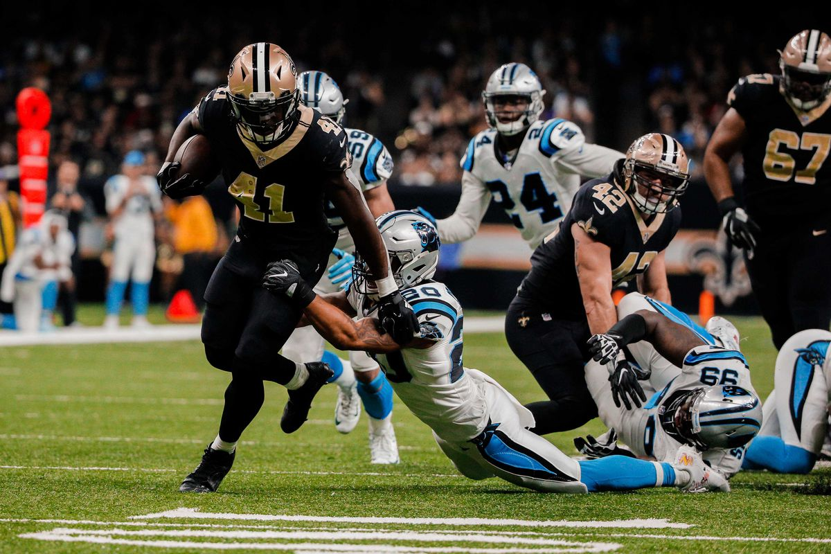 Brees, Saints advance by shutting down Panthers late