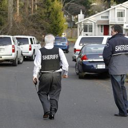 Pierce County Sheriff Paul Pastor left and detective Ed Troyer walk toward the smoldering remains of a house near Fredrickson, Wash., Sunday, Feb. 5, 2012, where, according to a sheriff's spokesman, three bodies were were found. The bodies are believed to be Josh Powell and his two sons. The explosion occurred moments after a Child Protective Services worker brought the two boys to the home for a supervised visit. (AP Photo/John Froschauer)