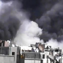 In this image made from amateur video released by the Shaam News Network and accessed Wednesday, April 18, 2012, smoke rises from buildings following purported shelling in Khaldiyeh district, Homs, Syria. Nearly a week after a cease-fire took effect, Syrian troops pounded a rebel stronghold Wednesday as the country's foreign minister met with his Chinese counterpart in Beijing during the latest round of talks aimed at preventing the truce from unraveling.(AP Photo/Shaam News Network via AP video) TV OUT, THE ASSOCIATED PRESS CANNOT INDEPENDENTLY VERIFY THE CONTENT, DATE, LOCATION OR AUTHENTICITY OF THIS MATERIAL