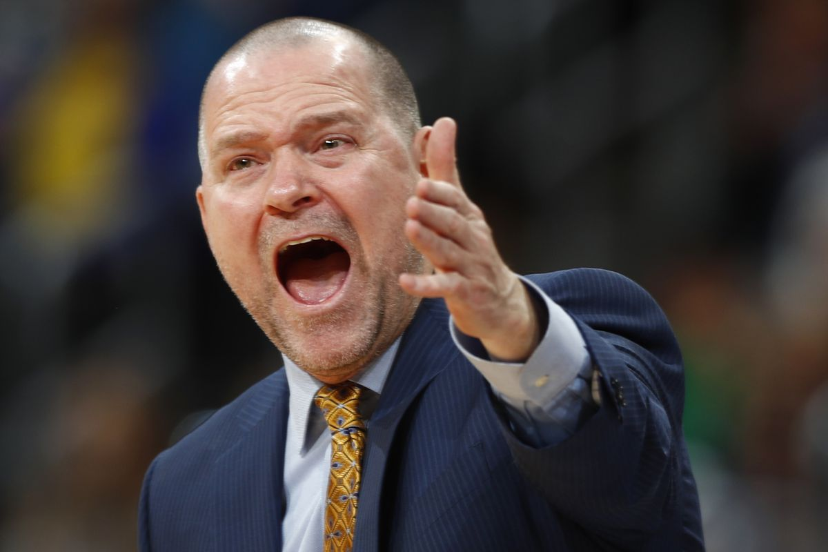 Denver Nuggets head coach Michael Malone yells at referees while facing Dallas in the second half of an NBA basketball game Monday, Dec. 19, 2016, in Denver. The Nuggets won 117-107. (AP Photo/David Zalubowski)