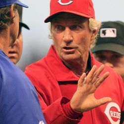 Cincinnati Reds acting manager Chris Speier goes over the ground rules prior to the start of a baseball game against the Los Angeles Dodgers, Friday, Sept. 21, 2012, in Cincinnati.