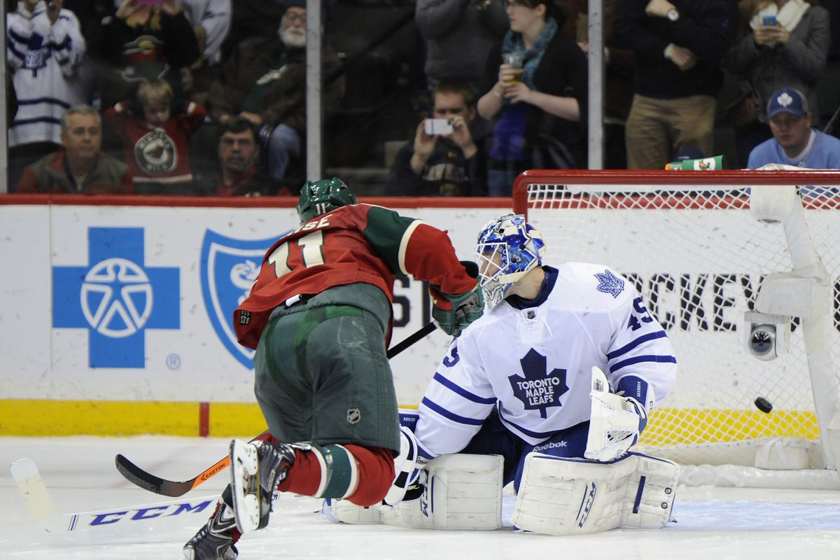"""What Parise is thinking right now: """"You can't stop me, Bernier!"""""""