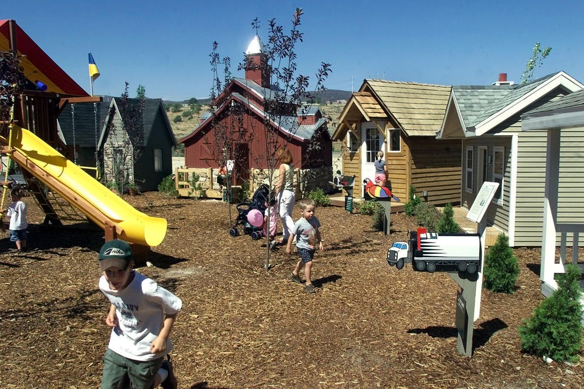 Children run from playhouse to playhouse exploring what each one on display at Thanksgiving Point in Lehi has to offer.