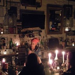 """Forgtmenot serves up fancy candelabras, cold draft beer, and an offer to cook anything from the remaining items in the fridge (steak, french fries, and eggs) [Photo: <a href=""""http://www.thelodownny.com/2012/10/lower-east-side-bar-crawl-post-sandy-version/"""