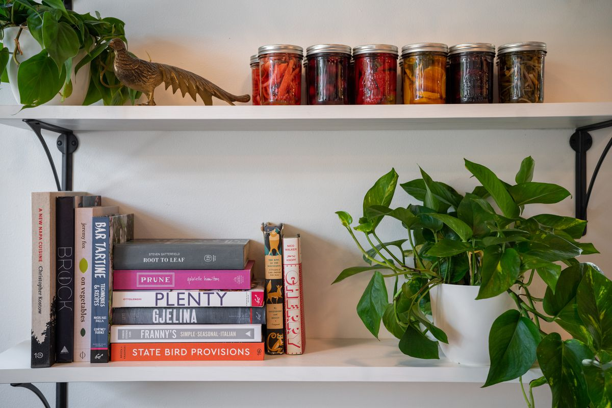 Jars of fermented produce, along with plants and books on shelves at Eight Row.