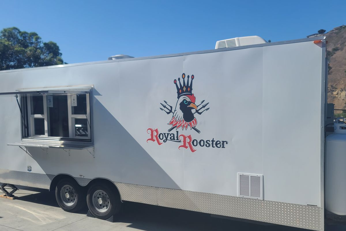 The white Royal Rooster's burger trailer parked behind Bitter Brothers Brewing Co. in Bay Park