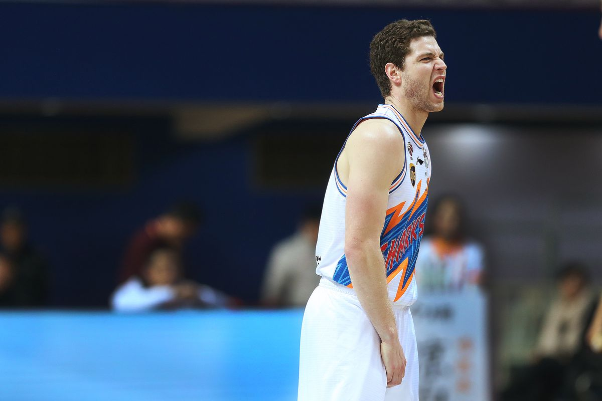 Jimmer Freddette grimaces after getting a minor injury while playing the Bayi Rockets in Shanghai, China.