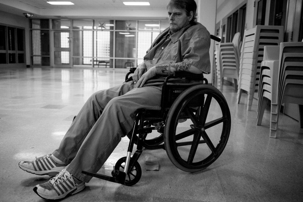 Michael Hodge, 51, sits in his wheelchair during an interview at a federal prison.
