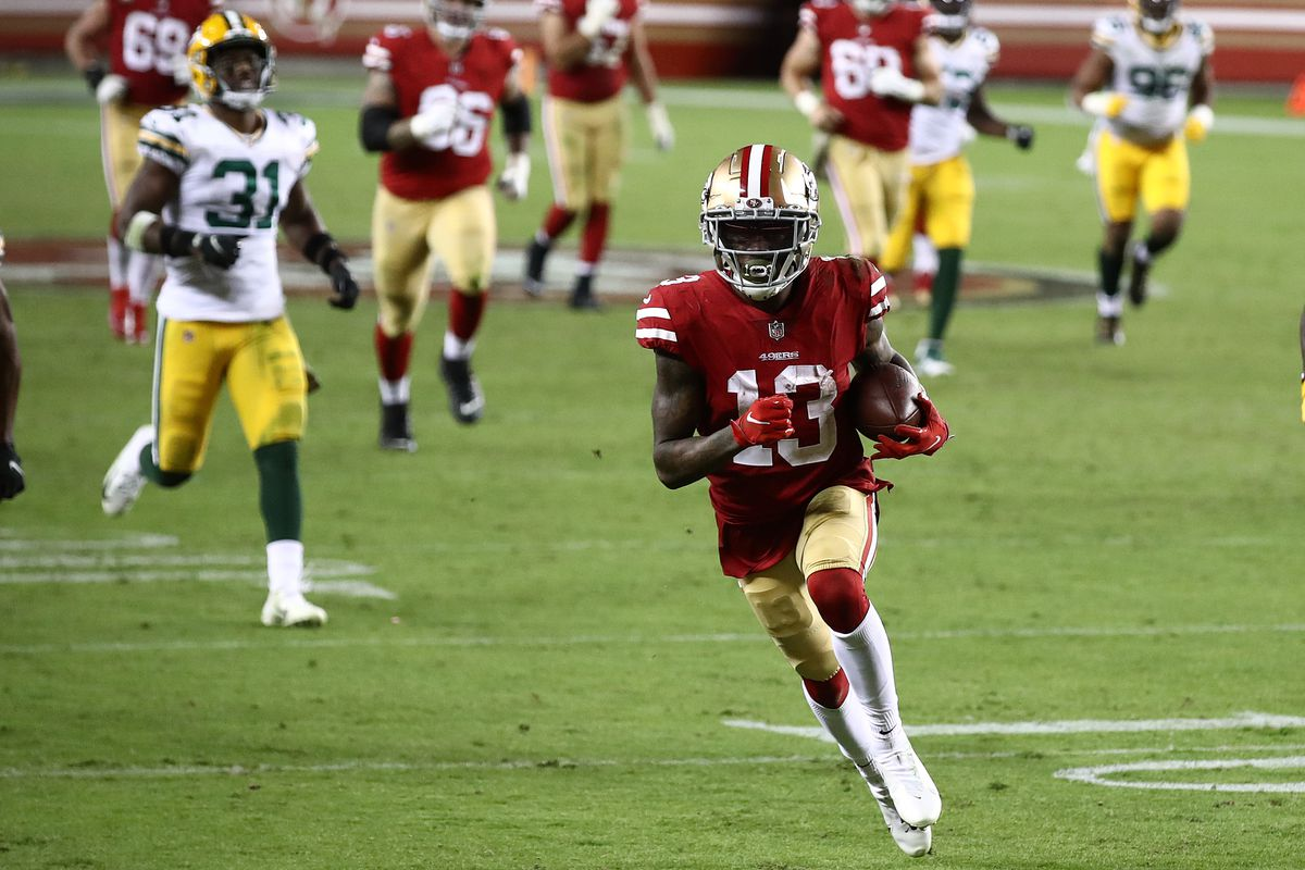 Richie James #13 of the San Francisco 49ers runs for a touchdown against the Green Bay Packers during the fourth quarter at Levi's Stadium on November 05, 2020 in Santa Clara, California.