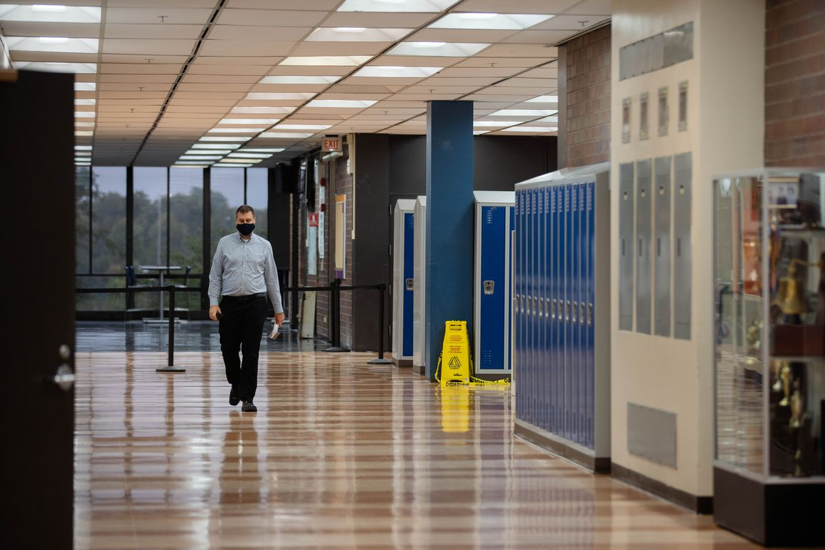 Assistant Principal Matthew Swanson walks inside Whitney M. Young Magnet High School on the first day back to school Tuesday morning, Sept. 8, 2020.