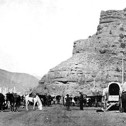 Pioneers stop at the mouth of Echo Canyon in the 1860s.