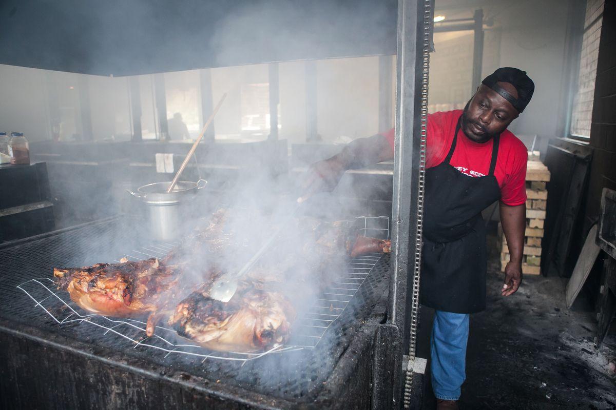 Rodney Scott prepares a whole hog