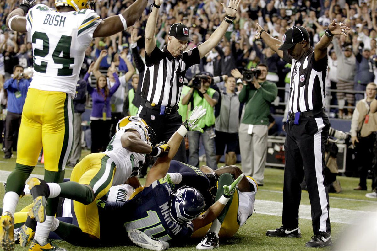 NFL replacement referees make conflicting signals in the end zone at the end of Monday night's Packers-Seahawks game.